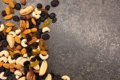 Tasty organic different nuts on dark table.  Healthy food and snack. Tasty organic different nuts on dark table.  Healthy food and snack stock photography