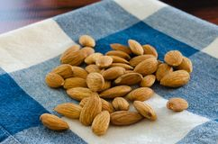 Organic Raw Almonds. Tasty organic raw almonds on a napkin.  Copy space Royalty Free Stock Photography