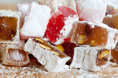 Tasty oriental sweets. sweet delicatessen Turkish delight lokum. Tasty oriental sweets (Turkish delight lokum) with powdered sugar. macro view stock photo