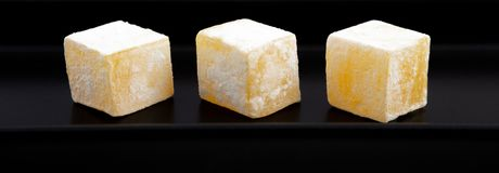 Tasty oriental sweets Turkish delight lokum. In a modern black plate close up view Stock Photo