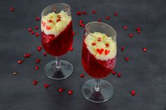 Tasty panakota with jelly and pomegranate. Red heart valentines day stock photo