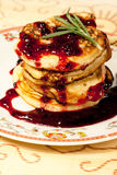 Tasty pancake with bilberry jam Stock Photo