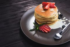tasty pancake with strawberries Stock Images