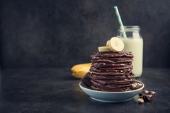 Tasty Pancake With Chocolate, Banana And Milk Bottle Royalty Free Stock Photo