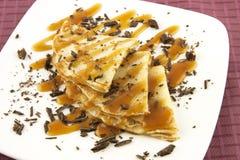 Tasty pancakes with caramel sauce Stock Image