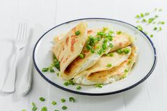 Tasty pancakes with cottage cheese and chive. On white table Royalty Free Stock Image