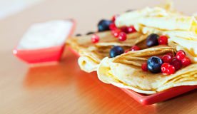 Tasty pancakes with cranberries and blueberries stock photo