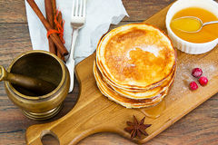 Tasty Pancakes with Cranberry and Honey Stack. Studio Photo royalty free stock image