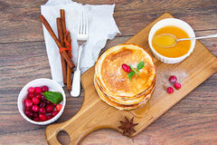 Tasty Pancakes with Cranberry and Honey Stack. Studio Photo stock photo