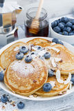 Tasty pancakes with fresh blueberries and honey for breakfast Stock Images