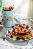Tasty pancakes with fresh fruits for breakfast Stock Photo