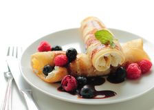 Tasty pancakes with fruits and chocolate syrup Royalty Free Stock Photos
