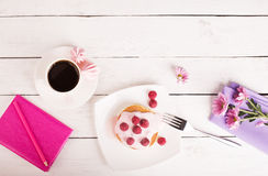 Tasty pancakes with pink sauce royalty free stock photography