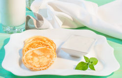 Tasty pancakes with in square plate and sour Royalty Free Stock Photos