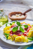 Tasty pappardelle pasta in the sunny kitchen Royalty Free Stock Photo