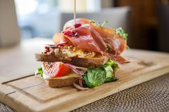 Tasty Parma Ham Sandwich On Wooden Plate Royalty Free Stock Photos