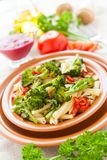 Tasty pasta with broссoli and bulgarian pepper Royalty Free Stock Photos
