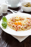Tasty pasta carbonara with egg yolk in the middle Royalty Free Stock Images
