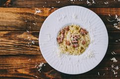 Tasty Pasta Carbonara. On home kitchen wooden rustic table Royalty Free Stock Photos
