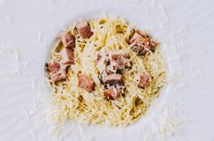Tasty Pasta Carbonara. On home kitchen wooden rustic table Royalty Free Stock Images