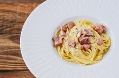 Tasty Pasta Carbonara. On home kitchen wooden rustic table Royalty Free Stock Photo
