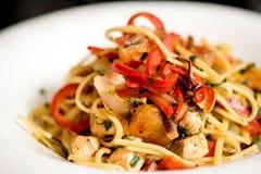 Tasty pasta with chicken. Stock Photo