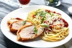 Tasty pasta with chicken parmesan slices and herbs Royalty Free Stock Photo