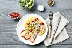 Tasty pasta with chicken parmesan slices and herbs Royalty Free Stock Image