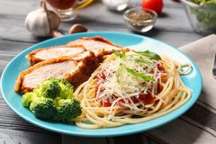 Tasty pasta with chicken parmesan slices and herbs Royalty Free Stock Photos