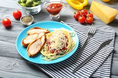 Tasty pasta with chicken parmesan slices Royalty Free Stock Images