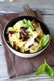 Tasty pasta farfalle with mushrooms Stock Photography