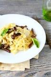Tasty pasta with mushrooms Royalty Free Stock Image