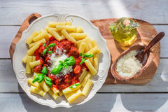 Tasty pasta penne with tomato sauce and basil Royalty Free Stock Photography