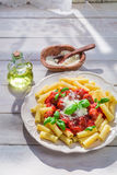 Tasty pasta penne with tomato sauce and parmesan Stock Photos