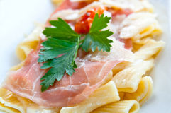Tasty pasta with roast ham Stock Images