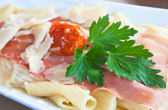 Tasty pasta with roast ham Stock Image