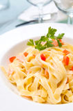 Tasty pasta with salmon Stock Images