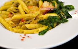 Tasty pasta, Thai Style. On white disk Stock Photos