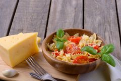 Tasty pasta with tomatoes and cheese. Copy space for text or recipe Stock Photos