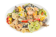 Tasty pasta with vegetables and cream sauce on plate Royalty Free Stock Images