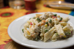 Tasty pasta with vegetables in a creamy sauce.  Stock Photo