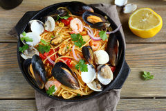 Tasty Pasta With Mussels, Squid, Parsley And Lemon Stock Image
