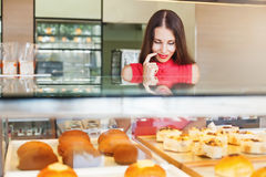 Tasty pastry. Woman choosing bakery items in a shop Royalty Free Stock Images