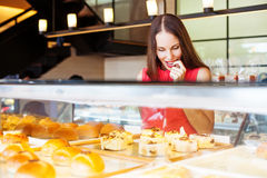 Tasty pastry. Woman choosing bakery items in a shop Royalty Free Stock Image