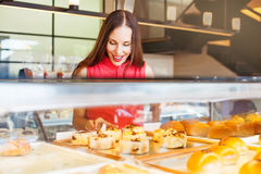 Tasty pastry. Woman choosing bakery items in a shop Stock Images