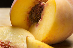 Tasty Peach. Peach cut open with pit royalty free stock photos