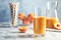 Tasty peach smoothie on table. Healthy drink royalty free stock image