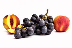 Tasty peaches, two nectarines and grapes. Tasty peach, organic nectarines.  and grapes non GMO Stock Images