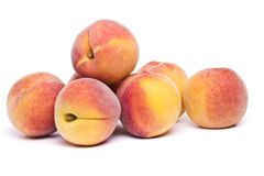 Tasty peaches on white. Close view of some tasty peaches  on a white background Royalty Free Stock Images