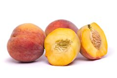 Tasty peaches on white. Close view of some tasty peaches  on a white background Royalty Free Stock Photo